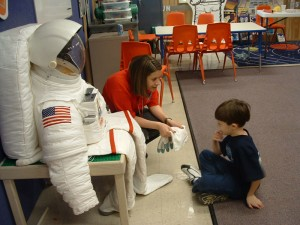 Child learns about spacesuits