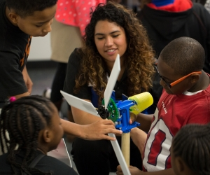An educator works with students in the Exploration Academy at the center.