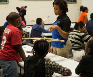 An educator instructs students.