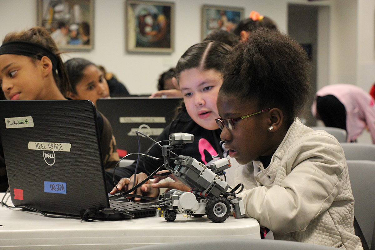 Students learn to code robots.