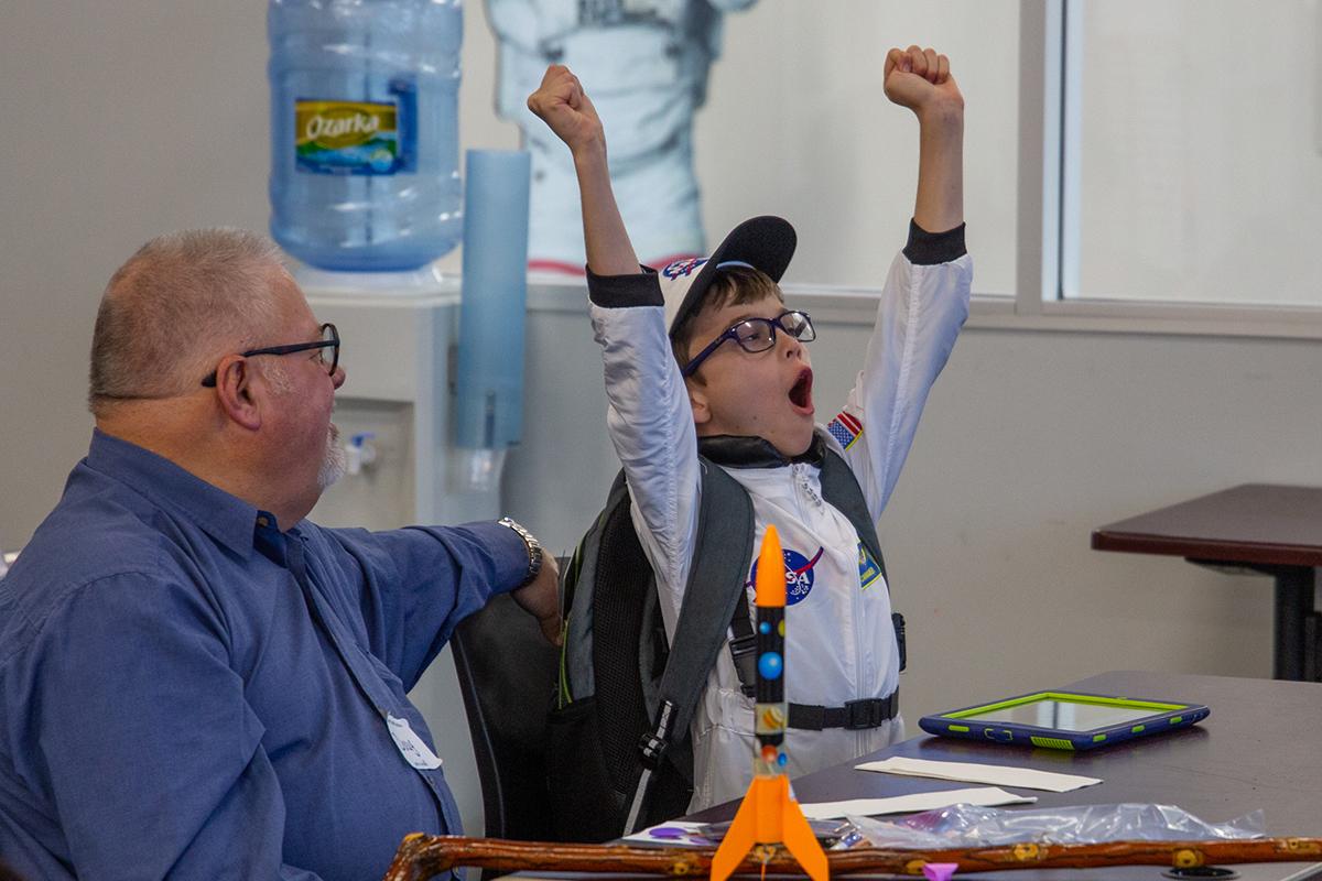 Child celebrates in Explorer Camp