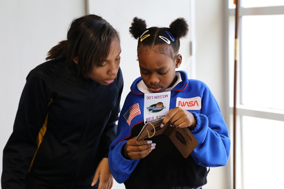 Middle school girls participate in the Girls STEM Academy at the center.