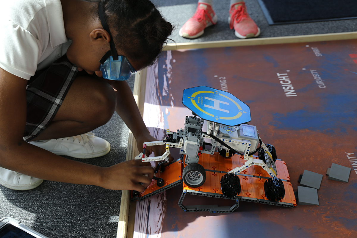 Girls STEM Academy students learn about coding and robotics