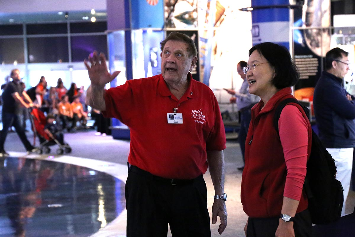 Volunteer leads tour through Independence Plaza.